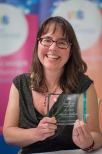 Sandra holding award