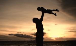 Man lifting child