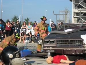 pic of firefighter raising car